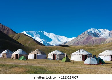Osh, Kyrgyzstan - Aug 20 2018: Morning Landscape of Lenin Peak (7134m) at Tourist Yurt camp of Tulpar Kol Lake in Alay Valley, Osh, Kyrgyzstan. Pamir mountains in Kyrgyzstan.