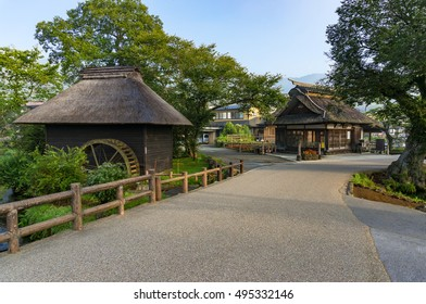 Oshino Hakkai historic village traditional thatch roof farmhouses and water wheel. Fuji Five Lakes, Japan
