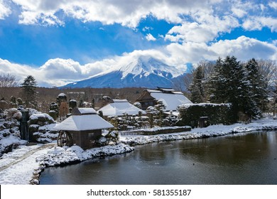 Oshino Hakkai, a small village in the Fuji Five Lake region with Mt. Fuji in the background. located on the sixth lake that dried out.