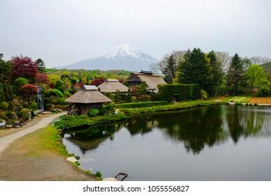 Oshino Hakkai, a small villagehistoric thatch roof farmhouses in the Fuji.