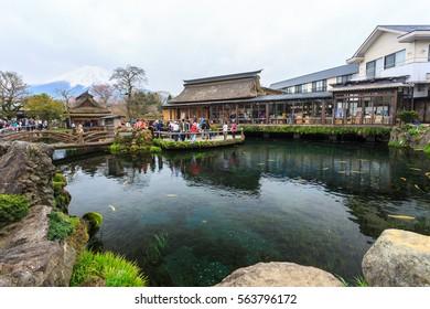 Oshino, Japan - April 10, 2016: Tourists visit Oshino Hakkai, a small village in the Fuji Five Lake region, located between Lake Kawaguchiko and Lake Yamanakako.