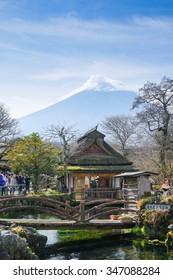 Oshino, Japan - November 17, 2015 :Tourists visit Oshino Hakkai, a small village in the Fuji Five Lake region, located between Lake Kawaguchiko and Lake Yamanakako.