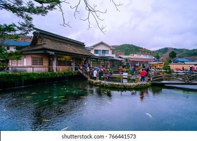 Oshino, Japan - November 2017: Tourists visit Oshino Hakkai, a small village in the Fuji Five Lake region, located between Lake Kawaguchiko and Lake Yamanakako.