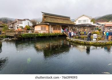 Oshino Japan - November 22 2017: Tourists travel in Oshino Hakkai, a famous village in the Fuji Five Lake region