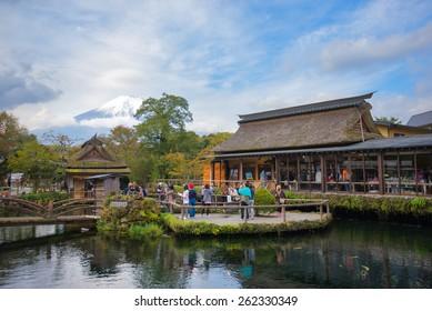 Oshino, Japan - October 24, 2012:Tourists visit Oshino Hakkai, a small village in the Fuji Five Lake, located between Lake Kawaguchiko and Lake Yamanakako. Oshino Hakkai Japan - October 24, 2012