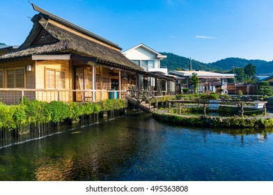 Oshino, Japan - September 2, 2016:Oshino Hakkai, Fuji Five Lakes. Japan countryside landscape of traditional thatch roof farmhouses and pond with crystal clear blue water