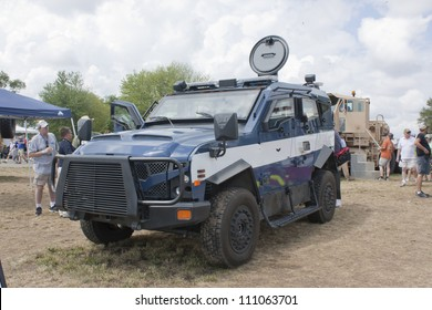 OSHKOSH, WI - JULY 27:  Front view of a Blue and White Oshkosh Corp TPV military vehicle on display the 2012 AirVenture at EAA on July 27, 2012 in Oshkosh, Wisconsin.
