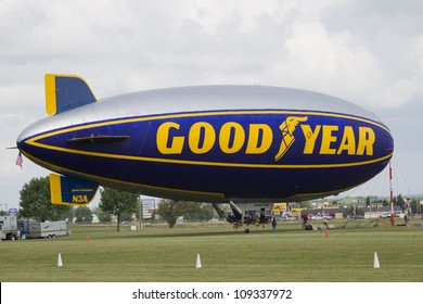 OSHKOSH, WI - JULY 27: The Good Year blimp Zeppelin, Spirit of Goodyear (with distinctive yellow stripe), gets ready to fly high over the 2012 AirVenture at EAA on July 27, 2012 in Oshkosh, Wisconsin.