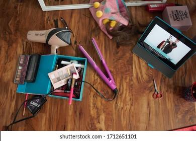 Oshkosh, WI / USA - April 10, 2020: Freshly cut hair lays on the floor next to an iPad displaying Brad Mondo's quarantine self-haircut YouTube tutorial during the coronavirus pandemic.
