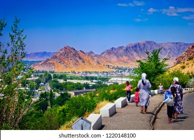 OSH/KYRGYZSTAN - AUG 05. Beautiful city view and unidentified women with children walk around Sulayman Mountain Museum on August 05, 2018 in Osh, Kyrgyzstan, Central Asia.