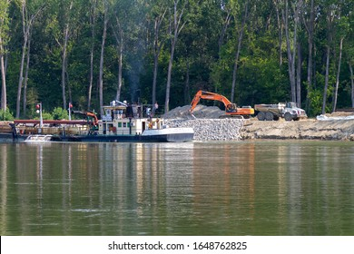 Osijek, Croatia, 08-22-2018: Construction of the riprap embankment on the Drava River