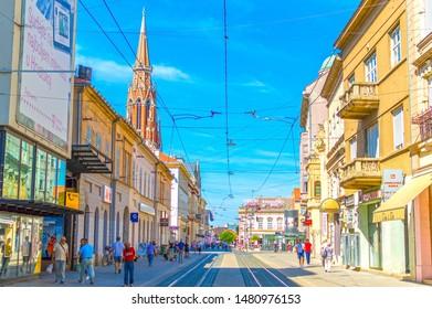 Osijek, Croatia- August 17, 2019.:  Main street of Osijek, Kapucinska Street, with pedestrian and tramway paths. Osijek is the main city of Northern Croatian region of Slavonia
