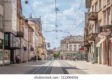 OSIJEK, CROATIA - MAY 12, 2018: Main street of Osijek, Ulica Strossmayera Street, with pedestrian and tramway paths. Osijek is the main city of Northern Croatian region of Slavonia