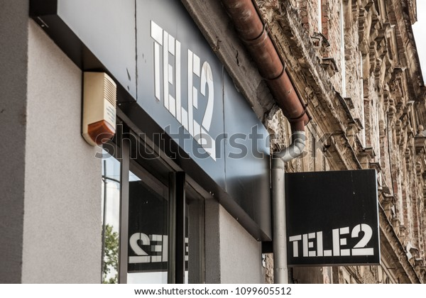 OSIJEK, CROATIA - MAY 12, 2018: Logo of Tele2 sign on their local shop in Osijek. Tele 2 is a European telecommunications operator from Sweden providing mobile phone and internet services