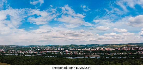Osinniki, RUSSIA - July 17, 2018: Aerial photography of city in Kemerovo region, city near river