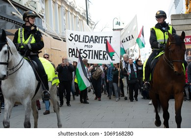 "OSLO - APRIL 14: Protesters carry a sign reading ""Solidarity with Palestinians"" in a march to Norway'??s parliament building to protest Israel's shooting of Palestinians in Gaza. Oslo, April 14, 2018."