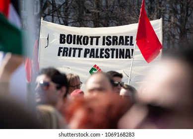 "OSLO - APRIL 14: Protesters carry a sign reading ""Boycott Israel, Free Palestine!"" in a march to Norway's parliament building to protest Israel's shooting of Palestinians in Gaza. Oslo, April 14, 2018"