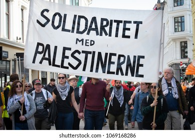 "OSLO - APRIL 14: Protesters carry a sign reading ""Solidarity with Palestinians"" as they march to Norway's parliament building to protest Israel's shooting of Palestinians in Gaza. Oslo, April 14, 2018"