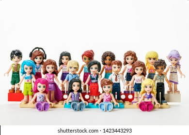 Oslo - April 25, 2019: LEGO minifigures from The friends series. Located on toy building blocks on white background