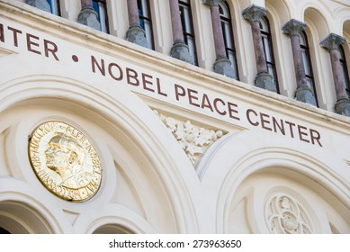 OSLO - APRIL 29: A golden image of the Nobel Peace Prize decorates the front of the Nobel Peace Center in Oslo, Norway, April 29, 2015.
