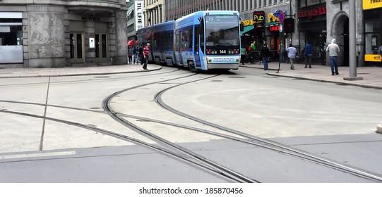 OSLO - AUGUST 16: Blue tram #13 on August 16, 2012 in Oslo, Norway.