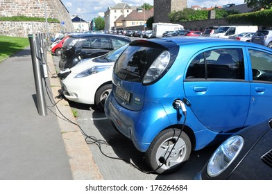 OSLO- AUGUST 17: Electric cars charging the battery on 17 August 2012 in Oslo, Norway. Parking and electric power is free of charge.