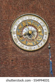 Oslo - the capital of Norway. The clock on one of the towers of the City Hall. Clear sunny summer day.