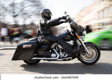 OSLO CITY, OSLO COUNTY / NORWAY – April 14, 2018: Motorcycle speeding through town rendered with motion blur.