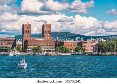 Oslo City Hall and Oslo cityscape from the sea during warm summer day