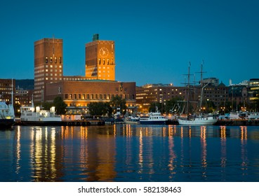 Oslo City Hall and harbor in twilight.