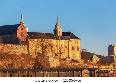 Oslo city skyline and harbor in front of Akershus Fortress during sunset in Norway