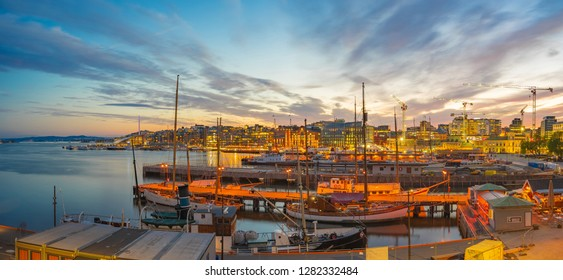 Oslo cityscape at night with view of Port in Oslo city, Norway.