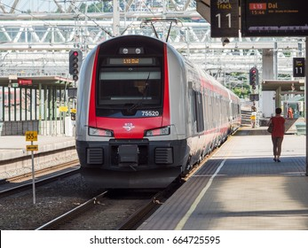 Oslo - June 15, 2017: Stadler Flirt Local Train leaving Oslo Central Station in Oslo, Norway. These fast and comfortable trains have become increasingly popular with travellers.