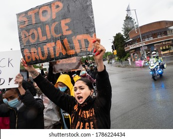 """OSLO - JUNE 5, 2020: A sign reads """"Stop Police Brutality"""" as thousands march from the U.S. embassy to Norwegian parliament to show solidarity with Black Lives Matter, Oslo, Norway, June 5, 2020."""