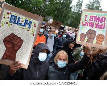 OSLO - JUNE 5, 2020: Thousands march from the U.S. embassy to Norwegian parliament to express solidarity with the Black Lives Matter movement, Oslo, Norway, June 5, 2020.