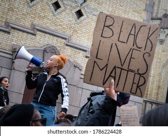 OSLO - JUNE 5, 2020: A young woman leads chants in front of Norwegian parliament in a demonstration to show solidarity with Black Lives Matter, Oslo, Norway, June 5, 2020.
