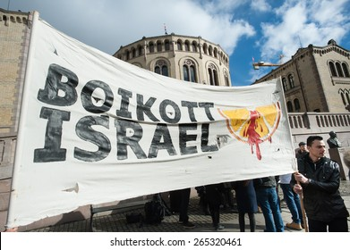 "OSLO - MARCH 30: Solidarity activists hold a banner reading ""Boycott Israel"" during a protest in front of the Norwegian Parliament building, Stortinget, Oslo, March 30, 2015."