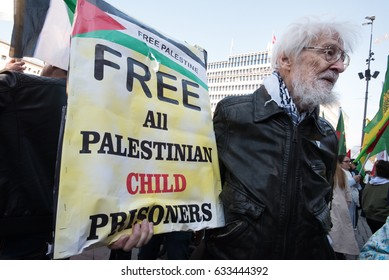 "OSLO - MAY 1: An activist holds a sign reading ""Free All Palestinian Child Prisoners"" at the annual May Day march in Oslo, Norway, May 1, 2017."