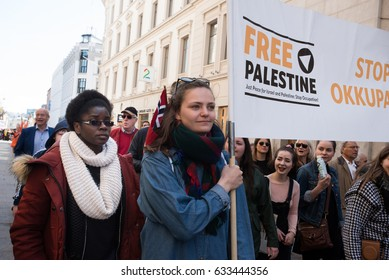 """OSLO - MAY 1: Activists carry a banner reading: """"Free Palestine"""" at the annual May Day march in Oslo, Norway, May 1, 2017."""