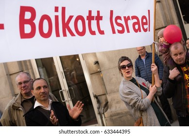 "OSLO - MAY 1: Activists carry a banner in Norwegian: ""Boycott Israel"" at the annual May Day march in Oslo, Norway, May 1, 2017."