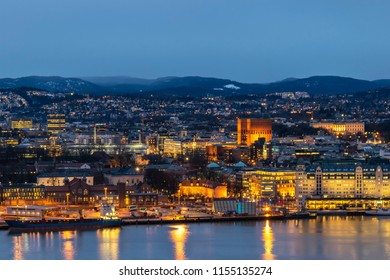 Oslo night city skyline at Oslo City Hall and Harbour, Oslo Norway