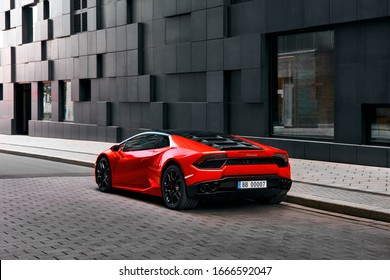 Oslo, Norway, 03.06.2016: Red Lamborghini Huracan in front of office building on Wismargata street