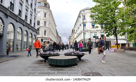 Oslo, Norway -05-11-2019: Karl Johan Street in the middle of Oslo, people walking by on a rainy day  in spring
