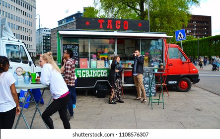 Oslo, Norway -05-13-2018: Food truck in the Oslo Harbour. Tacos for gringos. Taco food. Home made Mexican food. Young people enjoying the Mexican food in Oslo Harbor. Queso and quesadillas