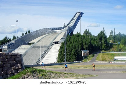 Oslo, Norway - 08/28/2013: Beautiful view of Holmenkollen Ski Museum and athletes, sunny day