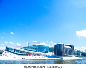 OSLO, NORWAY, 12 JULY 2015: People relaxing on the Oslo Opera House during a sunny day