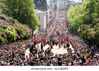 Oslo, Norway, 17th May 2014: National day in Norway. Norwegians at traditional celebration and parade on Karl Johans Gate street.