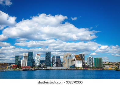 OSLO, NORWAY - 21 JUNE, 2015: Amazing view of modern business architecture in the center of Oslo on a background of blue sky and blue waters of the Oslo Fjord, Norway