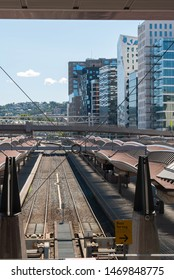 Oslo, Norway - 5th July 2019: Railway tracks at Oslo Central Station with Barcode skyline background.