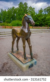 OSLO, NORWAY - 8 JULY, 2015: Statue of a young horse with scared body language located in the middle Birkelunden park.